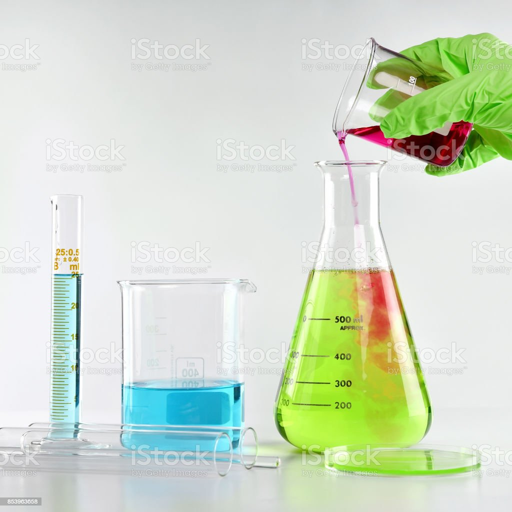 Chemist formulating dangerous solution substances, Scientist with equipment and science experiments, Laboratory glassware containing toxic chemical liquid. stock photo