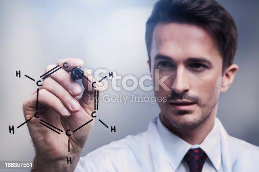 Chemist drawing benzene molecule