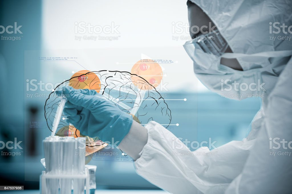 Chemist pouring liquid into test tubes with futuristic interface next to him stock photo