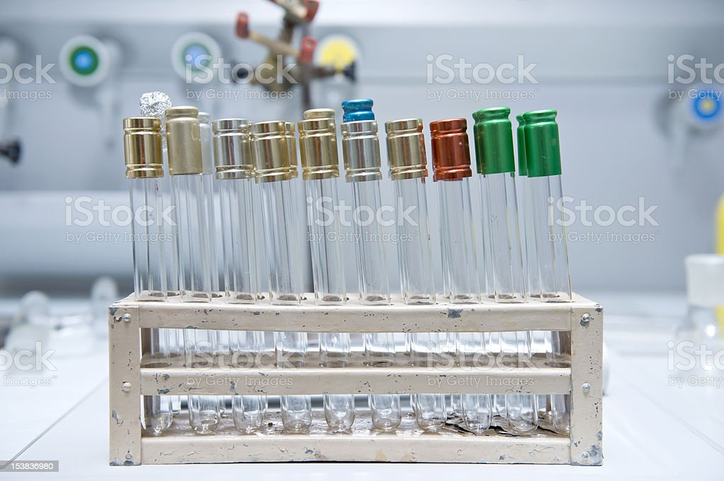 Chemistry lab test tubes with multi colored caps royalty-free stock photo