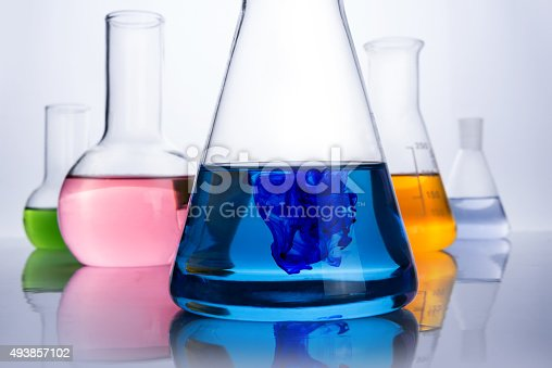 chemistry laboratory equipment and blue drop in the liquid in the flask