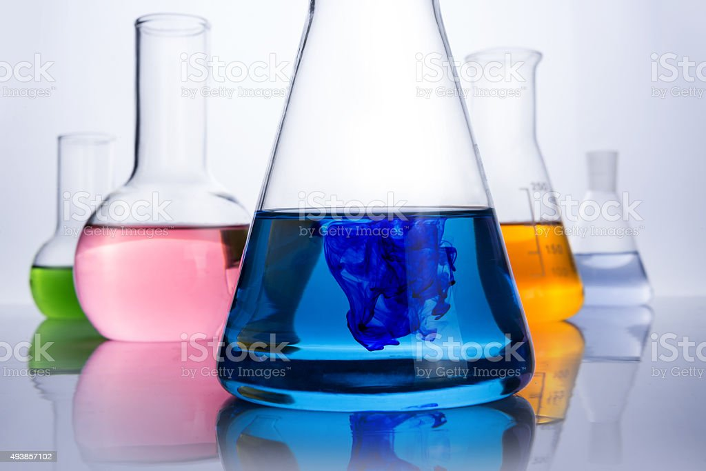 chemistry laboratory equipment and blue drop stock photo