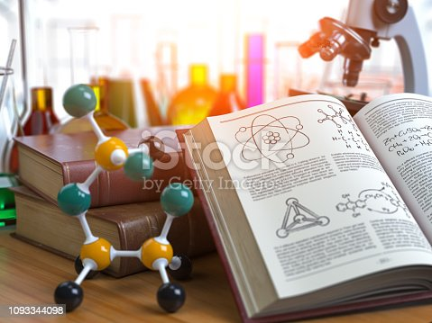 istock Chemistry .Laboratory equipment microscope with flasks, vials and model of molecule and book of chemistry. 1093344098