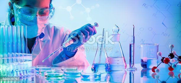 Woman With Pipette And Test Tubes