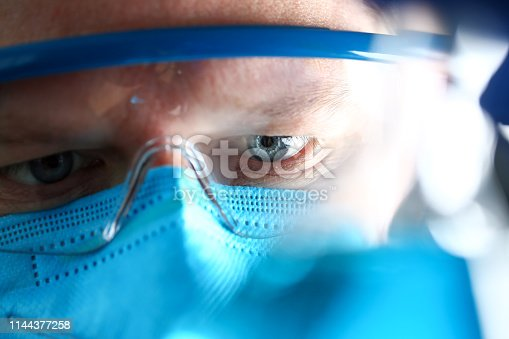 Chemistry man wearing protective mask hold in hand test sample closeup