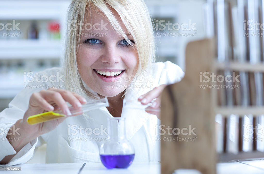 Chemistry student laughing while in a lab royalty-free stock photo