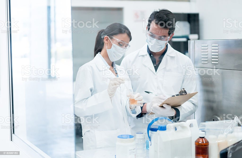 Chemists working at a the lab stock photo
