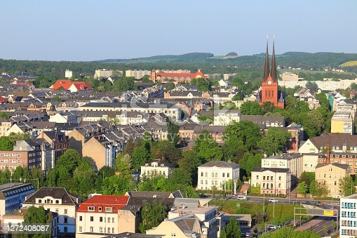 Chemnitz city, Germany. Urban aerial view in warm sunset light of Sonnenberg district.