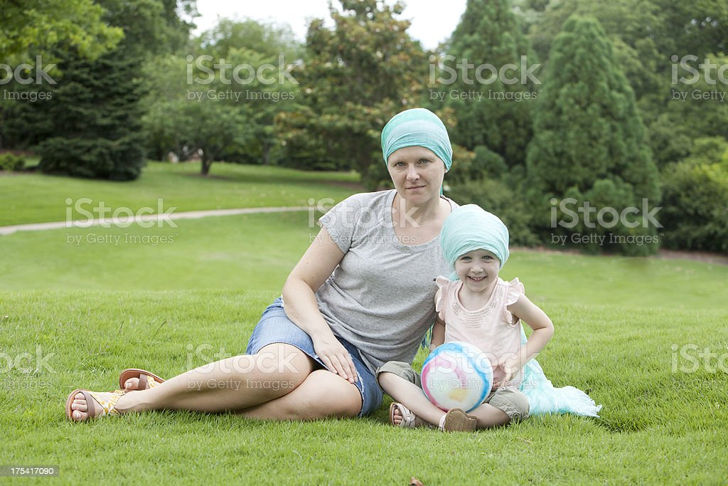 Chemo Woman and Girl in the Park stock photo