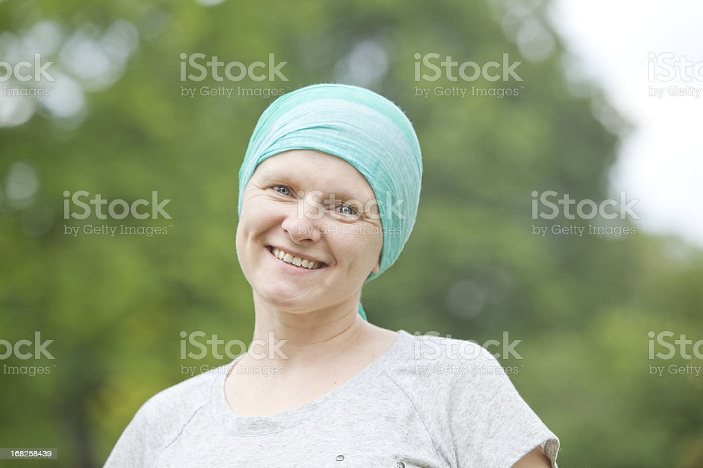Chemo Woman Happy in the Park stock photo