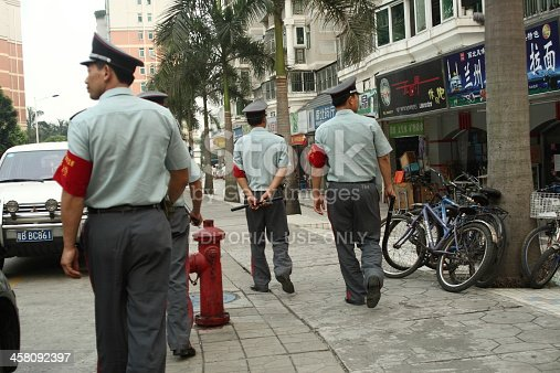 Shenzhen, P.R. China, 14. Oct. 2006: uniformed, communist (non-police) eye of the law with nightsticks and red armbands