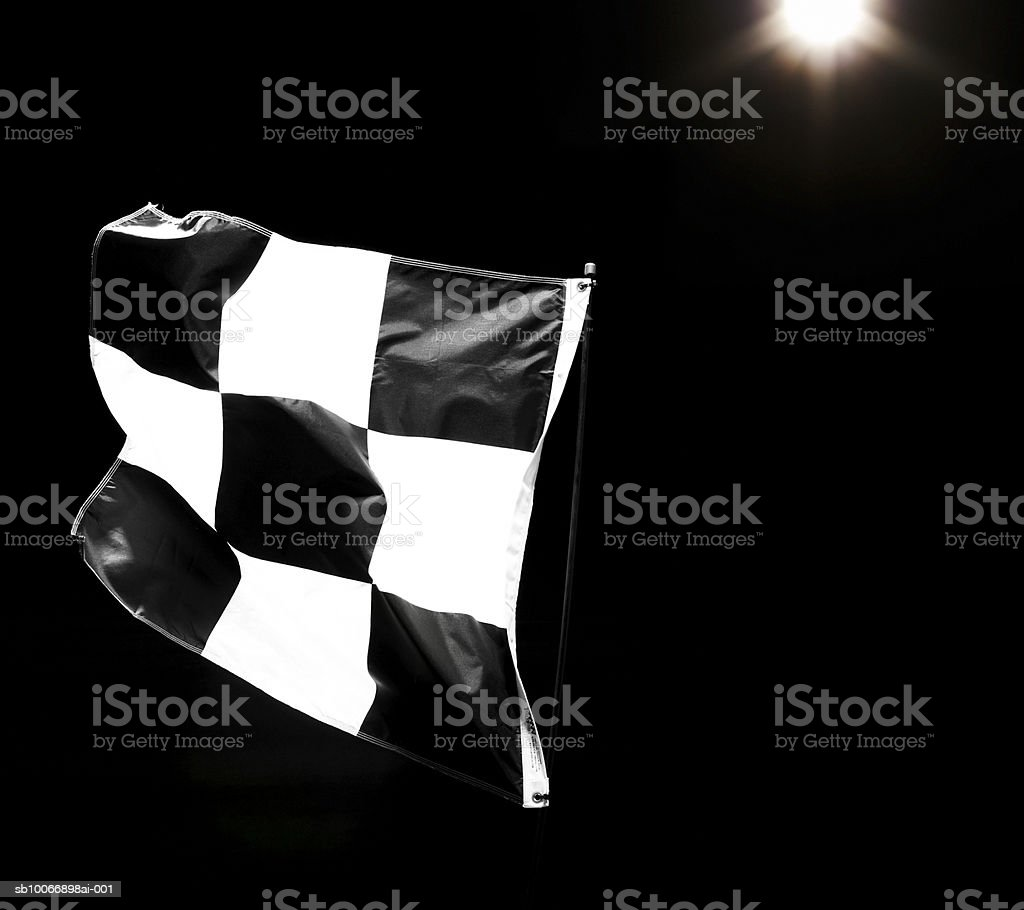 Chequered flag on black background royalty free stockfoto