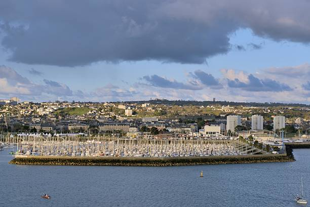Cherbourg Marina and Town Docking in Cherbourg with the marina and town in the background and some high rise condos or apartment buildings along the shore cherbourg stock pictures, royalty-free photos & images