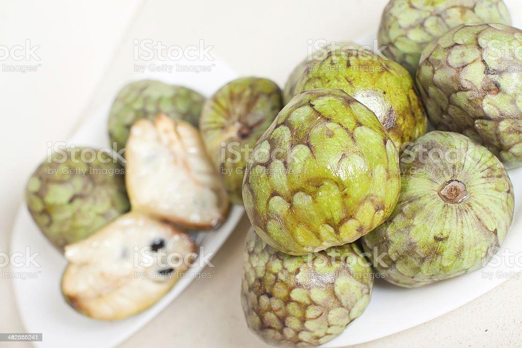 cherimoya  on plates stock photo