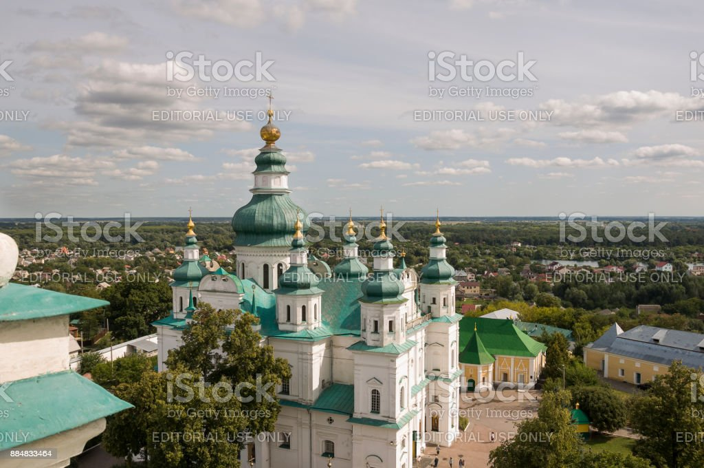 Chernigov, Ukraine.  August 15, 2017. Christian orthodox white church with green domes and gold crosses. View from high. Calm sky above stock photo
