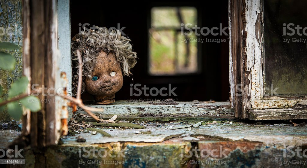 Chernobyl - Doll looks out a window stock photo