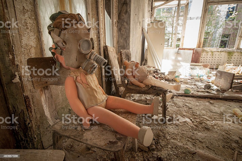 Chernobyl - Gas mask doll on chair stock photo