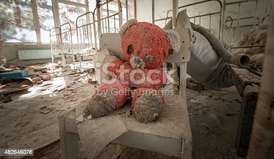 istock Chernobyl - Teddy bear in abandoned kindergarten 482646076