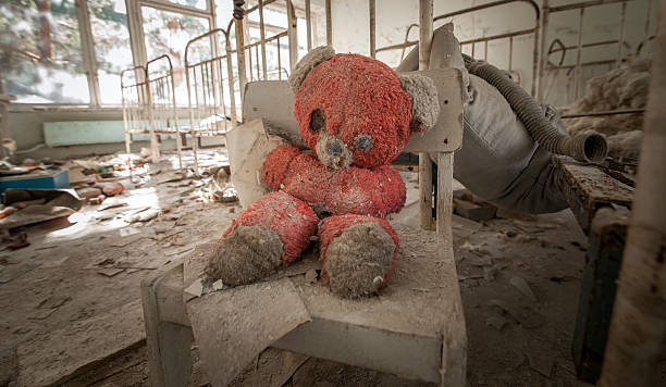Chernobyl - Teddy bear in abandoned kindergarten stock photo