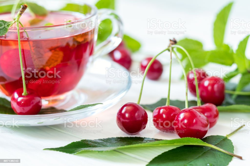 Cherries and cherry flavored drink in glass cup stock photo