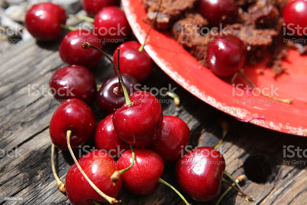 Cherries and chocoloate cake on red plate royalty-free stock photo
