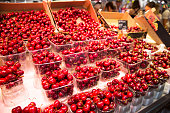 Gorgeous red cherries at fruit stand