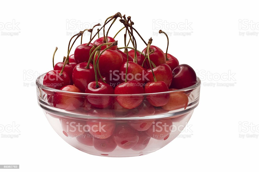 Cherries in a glass bowl royalty free stockfoto