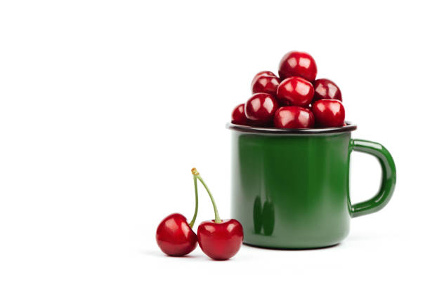 Cherries in green glass isolated stock photo