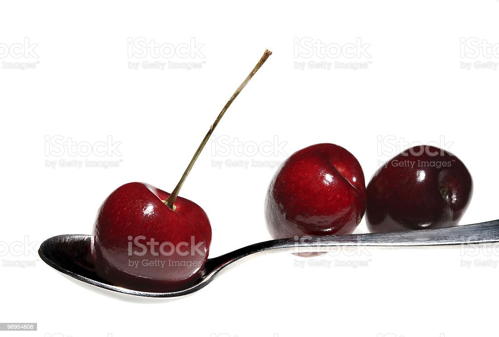 Cherries on a spoon royalty-free stock photo