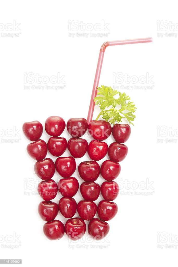 cherries shaped a glass of juice royalty-free stock photo