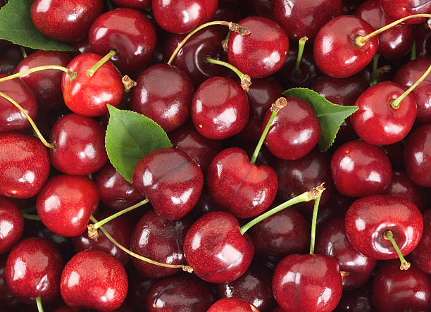 Cherries sweet with stem and Leafs stock photo