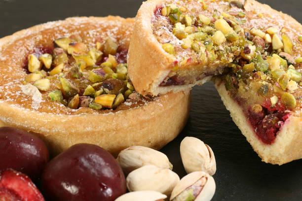 Cherry and pistachio tartlets stock photo