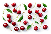 Cherry background. Cherries flat design. Cherry with leaves.