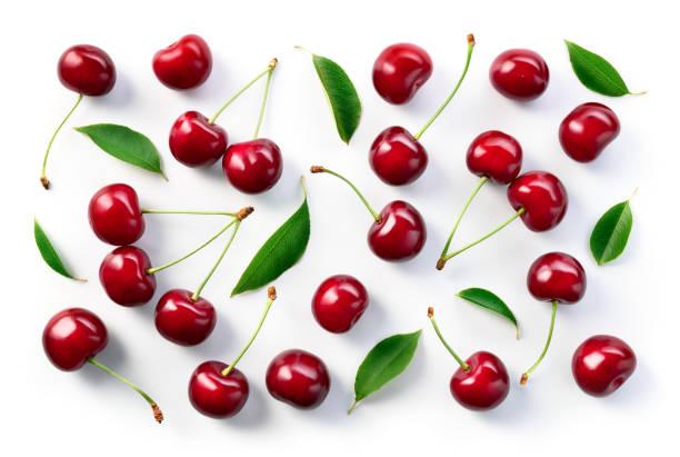 fondo de cereza. diseño plano de las cerezas. cereza con hojas. - cereza fotografías e imágenes de stock