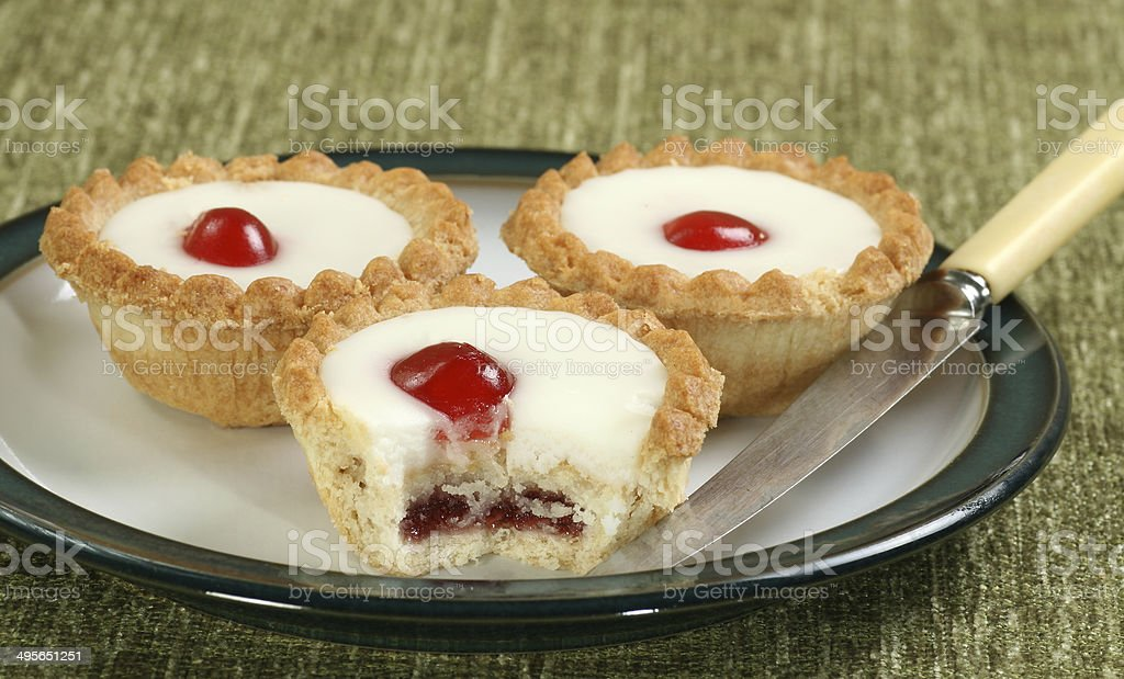 cherry bakewells on a plate stock photo