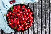 Cherry berries - full plate of cherries. Top view, copy space.