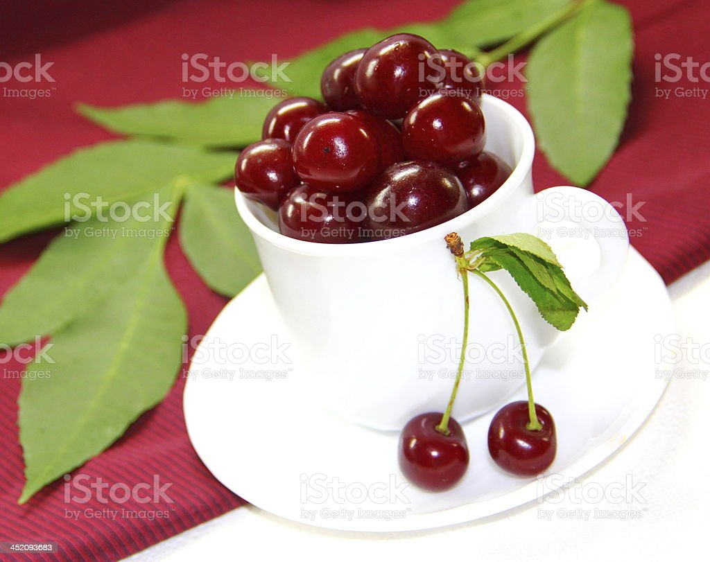 Cherry berries in white cup royalty-free stock photo
