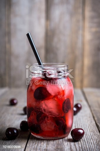 istock Cherry cocktail with ice in glass jar 1016020938