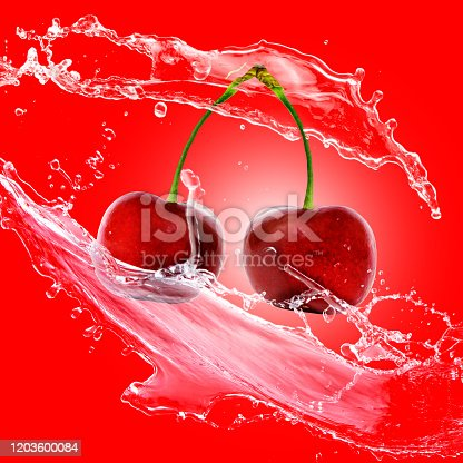 cherry fruit - water splash isolated on a red background