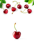Cherry fruit and leaves composition and creative layout isolated on white background. Healthy eating and dieting food concept. Summer fruits arrangement and design elements. Top view, flat lay