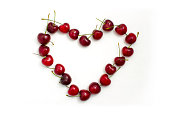 A heart shape made out of cherries encouraging healthy eating.