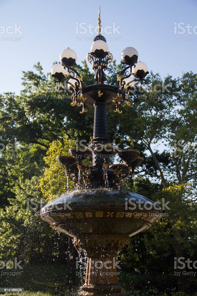 Cherry Hill fountain with blue sky and trees in summer at Central Park stock photo