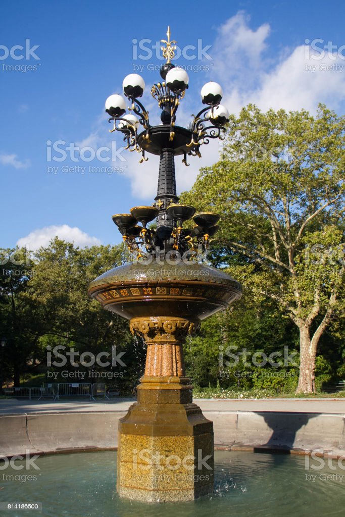 Cherry Hill fountain with trees blue sky in summer at Central Park stock photo