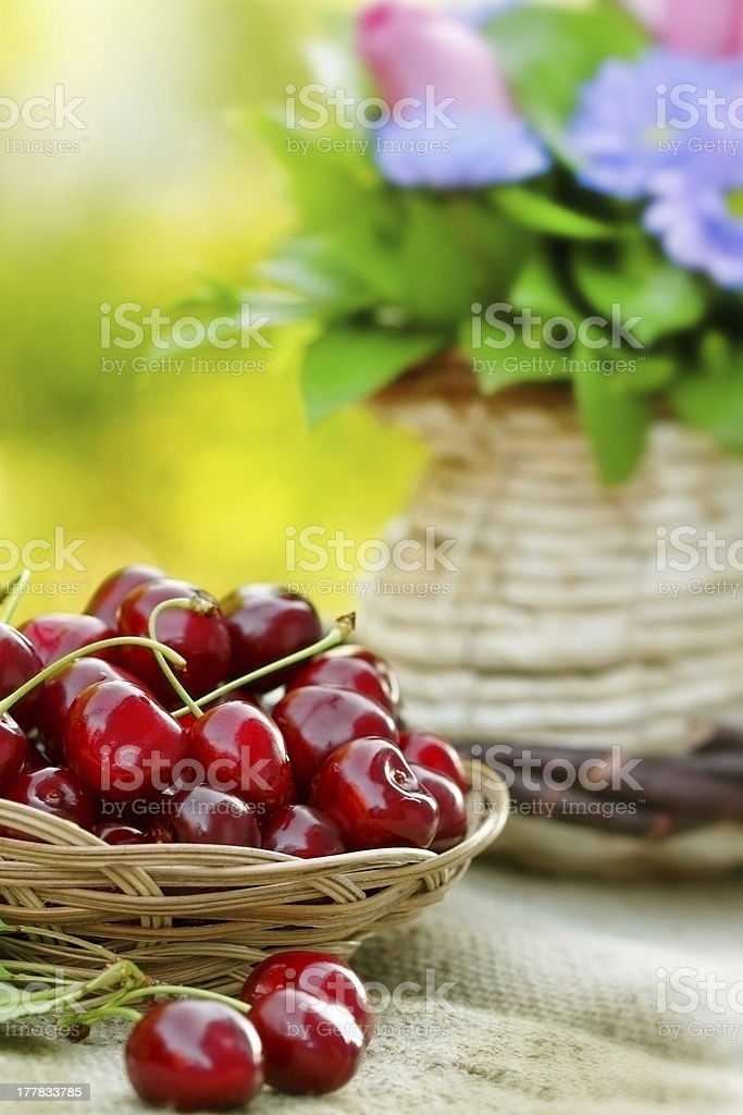 Cherry (fruit) in wicker the basket royalty-free stock photo