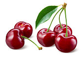 Cherry isolated. Cherries with leaves on white background. Sour cherries on white. With clipping path. Full depth of field.