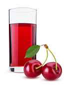 cherry juice in a glass two sweet cherry berry with leaf on a branch isolated on white background. Clipping Path. Full depth of field.
