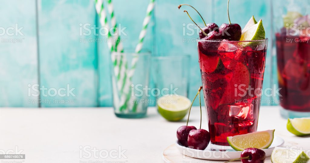 Cherry Limeade, lemonade, cola, cocktail in glass. stock photo