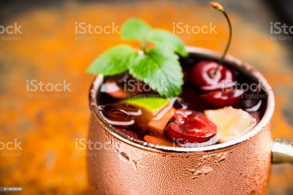 Cherry moscow mule in copper mug stock photo