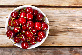 Cherry on a wooden background. View from above. close up