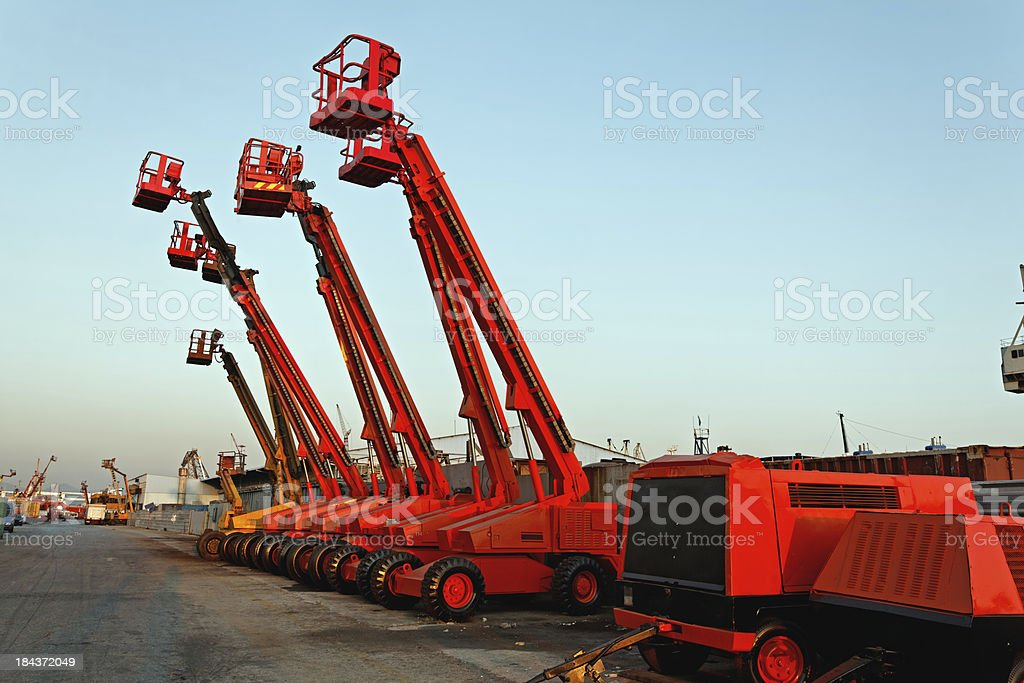 Cherry pickers in construction site stock photo